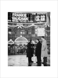 A group of men talking outside the Palace Theatre, Shaftsbury Avenue: c. 1955