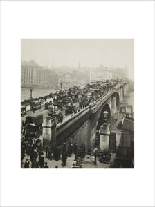 People crossing London Bridge; c1900