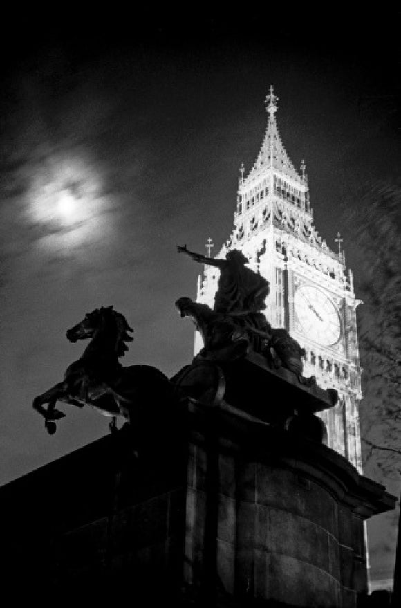 Statue of Boudica with Big Ben floodlit behind.