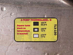 Label on tray with one temperature element turned black along its edges only.
