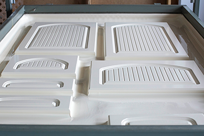 MDF cabinet doors with laminated white RTF prior to being separated