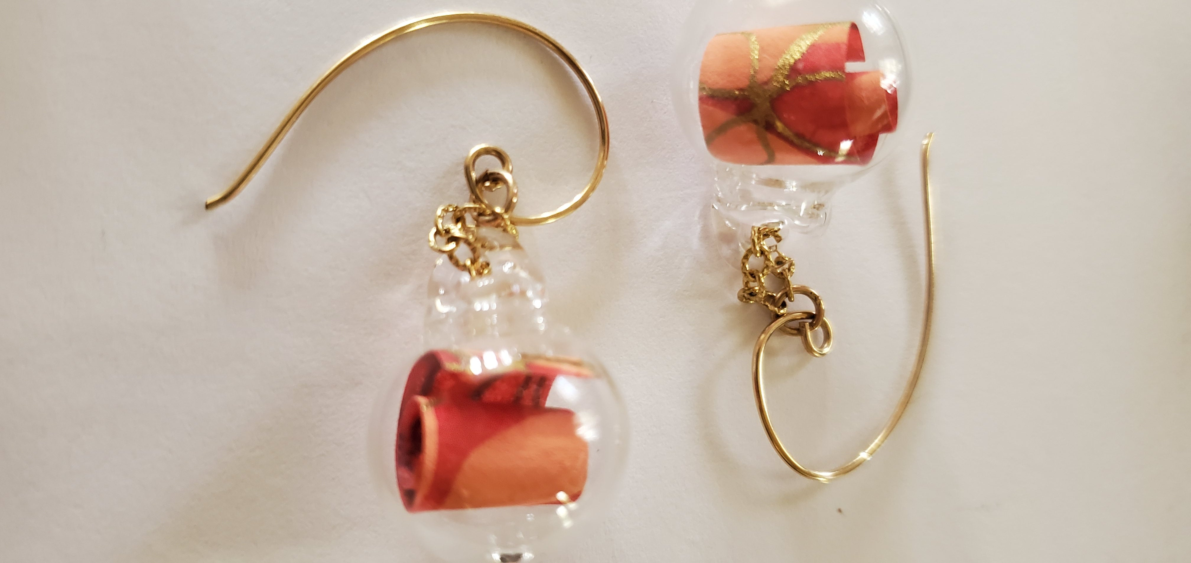 gold and red scrolls earrings