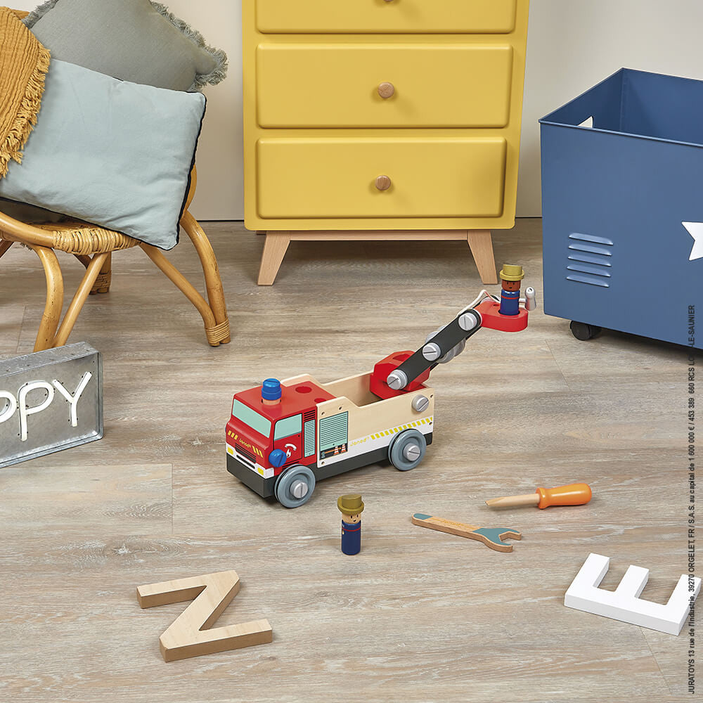 a construction kit, as kids try to put the beautiful fire engine together using the nuts, bolts and screws provided.