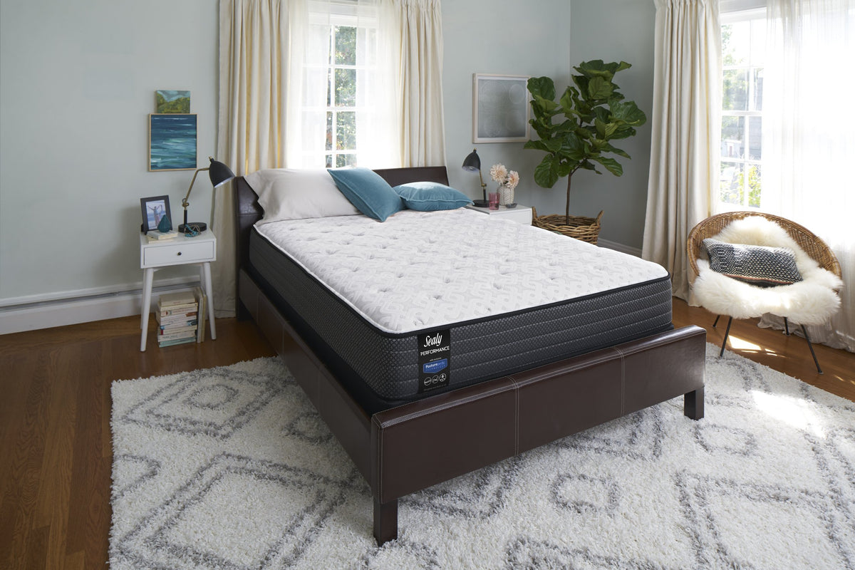 Sealy Response Performance Cushion Firm Mattress Bedroom slant view