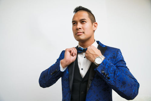 Man wearing blue silk tuxedo