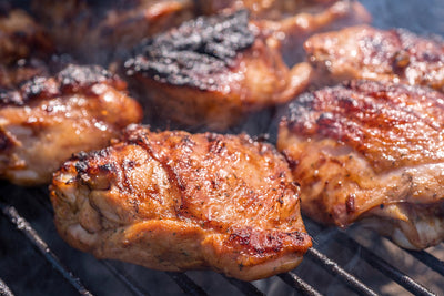 Grilled chicken thigh on the grill