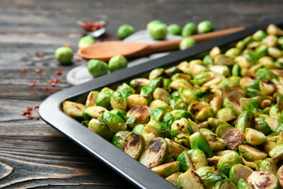 Baking tray with roasted brussel sprouts on table