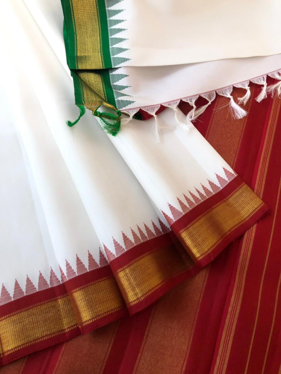 Traditional korvai Kanchivaram - A rare find pure white korvai pure zari kanchivaram with traditional red and green ganga jammuna woven korvai borders