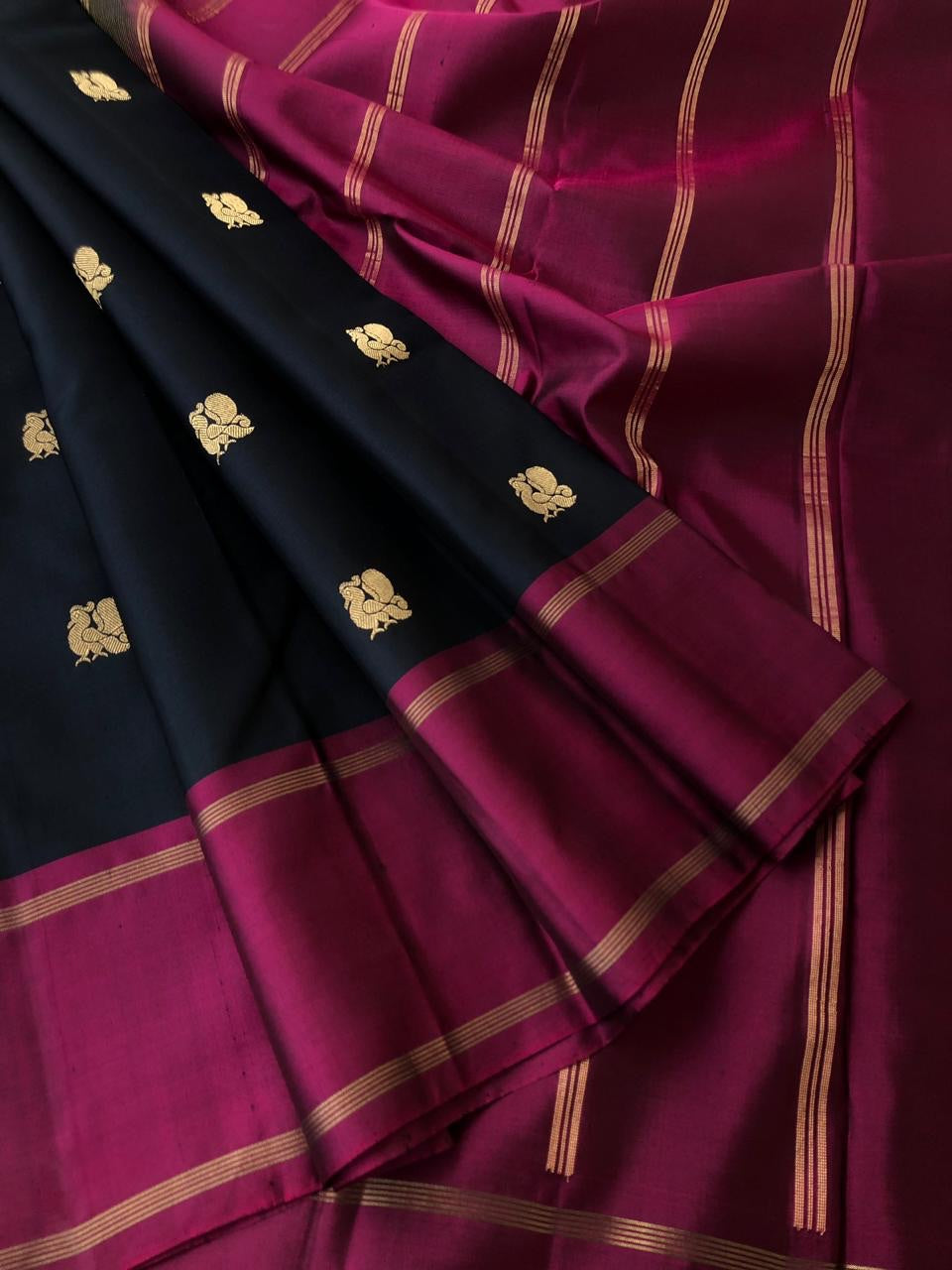 Kanchivaram - beautiful jet black kanchivarm with annapakshi woven butties all over