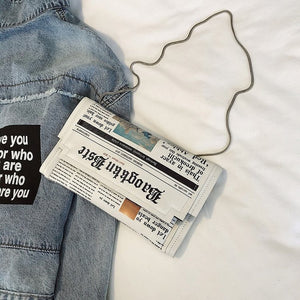 Newspaper Modeling Day Clutch Bag