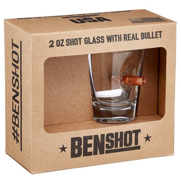 Shot glass with bullet imbedded in the side in retail packaging