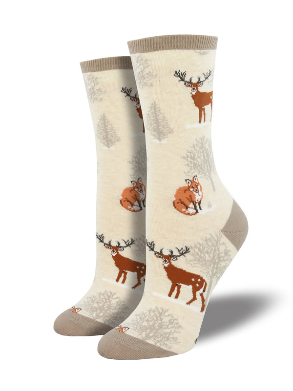 White socks featuring moose and fox in a winter forest.