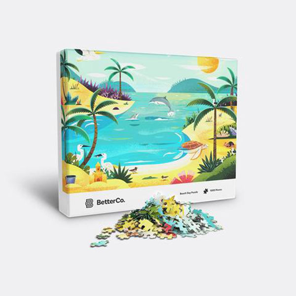Beach day puzzle box with mound of pieces in front