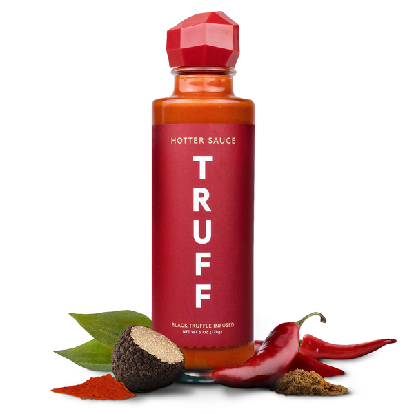 Truff Hotter Sauce bottle with black truffle and chili pepper