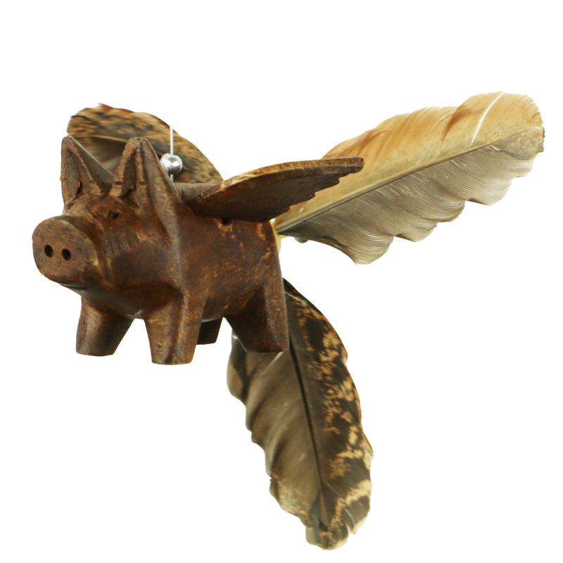 Closeup of Pig Whirly Mobile showing hand carved flying pig with duck feather tail.