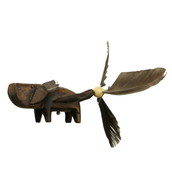Closeup of Dog Whirly Mobile showing hand carved flying dog with duck feather tail.