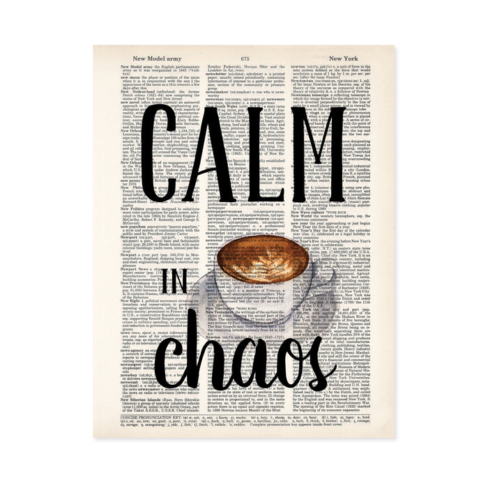 calm in chaos with a water color coffee cup with cream design on a saucer printed on a salvaged dictionary page
