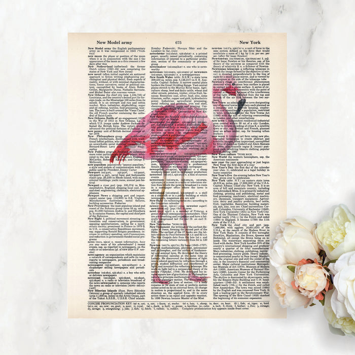 pink flamingo in watercolors printed on a dictionary page