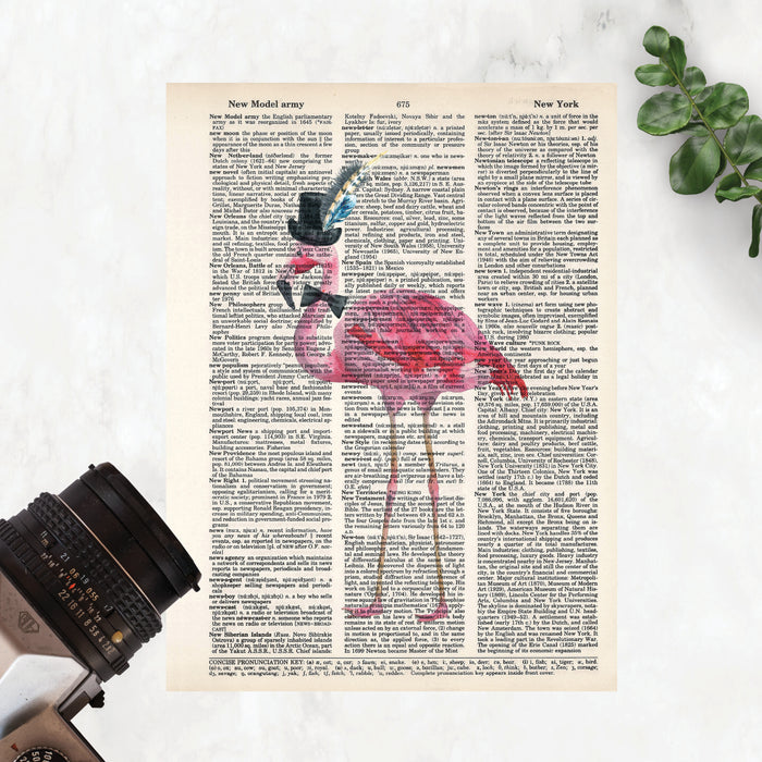 watercolor flamingo wearing a top hat with feathers and a bow tie printed on salvaged dictionary paper
