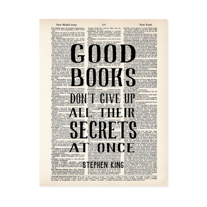 good books don't give up their secrets at once Stephen King quote printed on a dictionary page