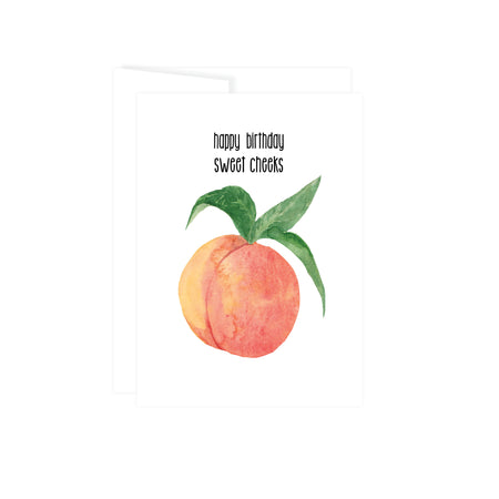 happy birthday sweet cheeks in black text above a peach with green leaves, card is blank inside