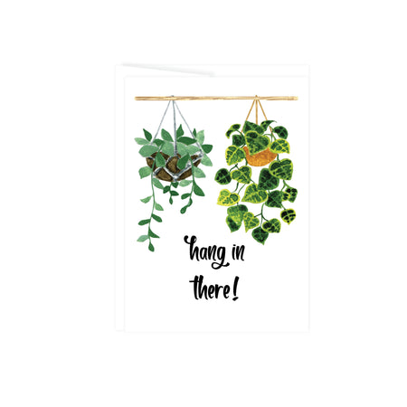 hang in there in black text with two hanging plants above, greeting card is blank inside