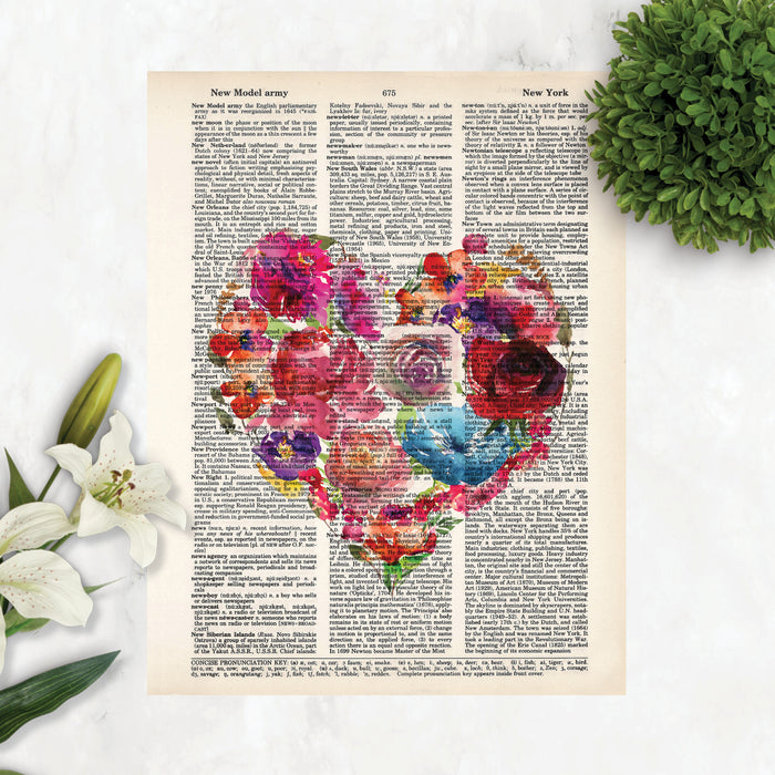 heart shape with watercolor flowers in pinks, reds, purples, yellows, and blue tones printed on a salvaged dictionary page