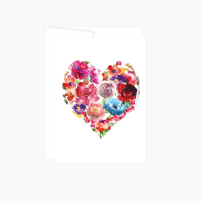 greeting card with a heart made of of watercolor flowers in shades of reds, pinks, purples, and blues card is blank insides