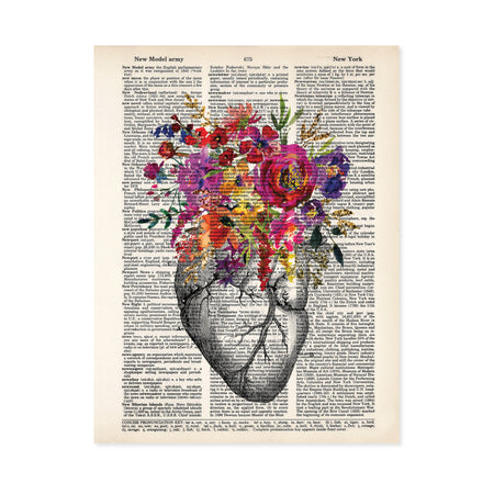 vintage etching of an anatomical heart topped with watercolor flowers in shades of pink, purple, yellow, and golden tones printed on a salvaged dictionary page