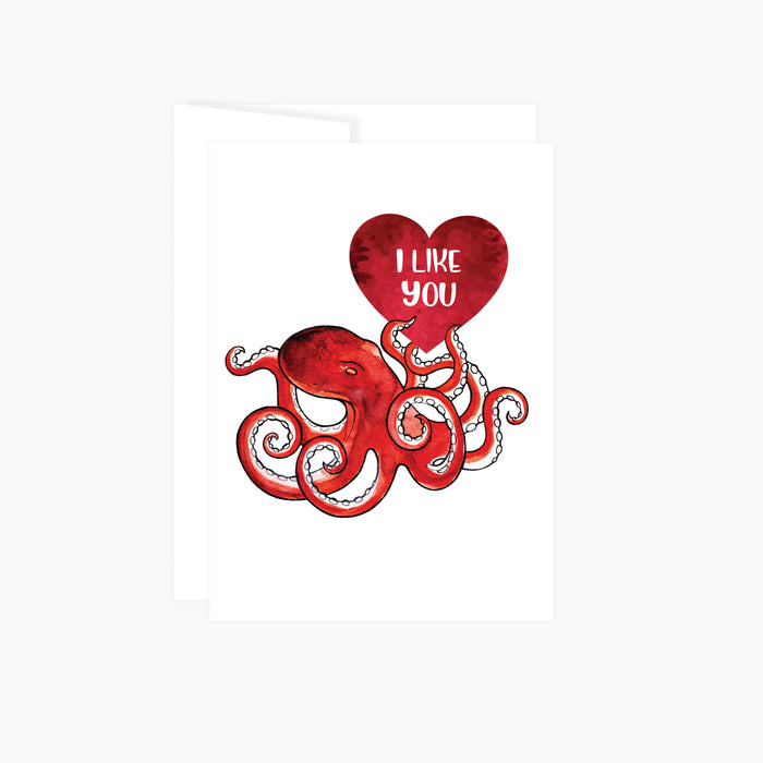 red octopus holding a red heart with words I like you, greeting card is blank inside