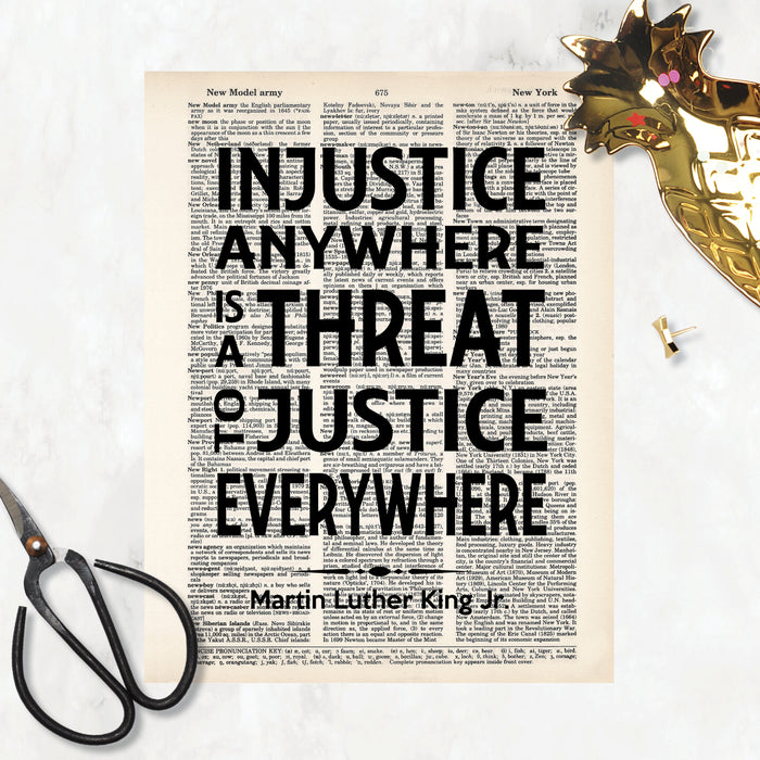 Martin Luther King Jr Quote Injustice anywhere is a threat to justice everywhere in black ink printed on salvaged dictionary paper