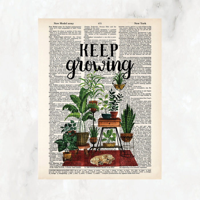 keep growing in black ink above a scene of plants on plant stands anchored by a rust colored rug with a yellow sleeping puppy printed on salvaged dictionary page