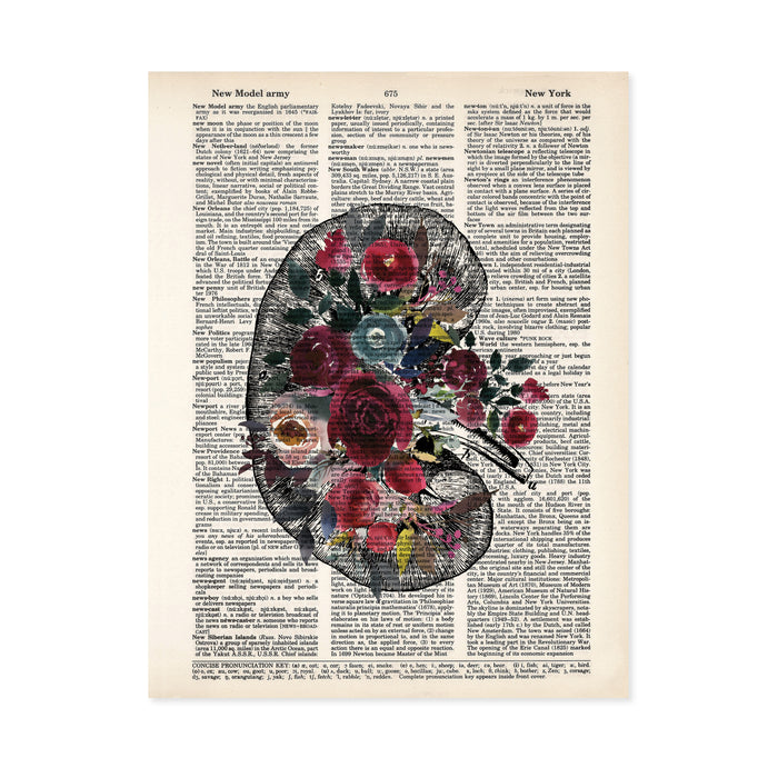 vintage kidney etching topped with watercolor flowers in shades of berry reds and blues printed on a dictionary page