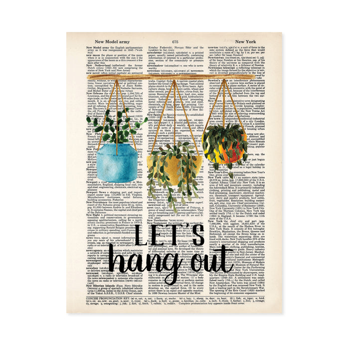 three potted plants hang from a bamboo rod above the words let's hang out in black printed on a salvaged dictionary page