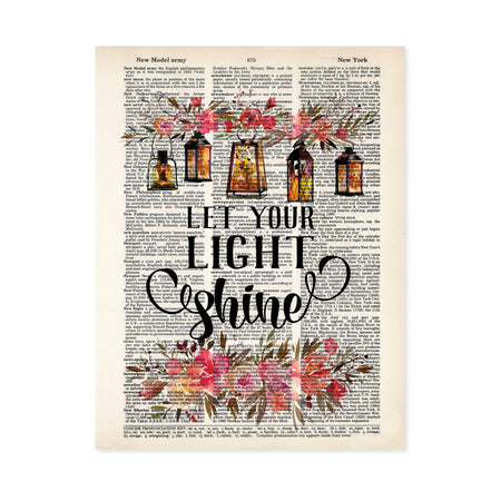 let your light shine is printed in black ink, at the top of the page there is a spray of pink and salmon colored flowers with five lanterns glowing amber with light, there are matching flowers and greenery at the bottom of the dictionary page