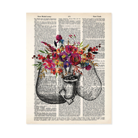 liver etching with watercolor flowers in pinks, purples, yellow and golden tones with greenery printed on a dictionary page