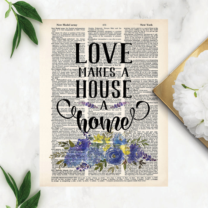 love makes a house a home printed above a spray of blue flowers with greenery on salvaged dictionary page