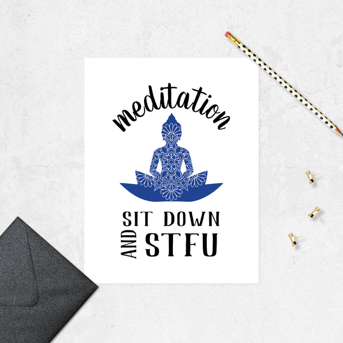 meditation text arced over a blue buddha figure with a mandala on it and the text sit down and STFU below printed on matte white paper