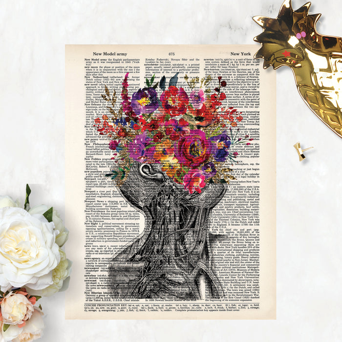 vintage neck with pink purple and yellow flowers replacing the face printed on a dictionary page