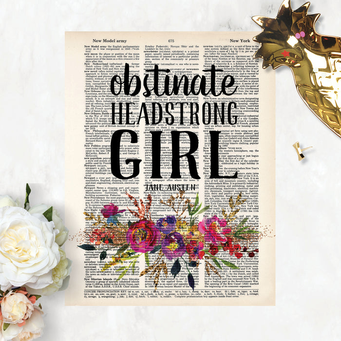obstinate headstrong girl Jane Austen quote with watercolor flowers in pinks, purples, and golden tones with greenery printed on dictionary page