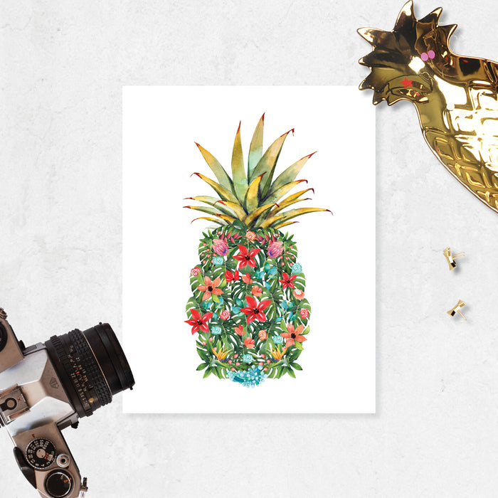 watercolor monstera leaves along with pink, red, peach, and blue flowers along with red and blue shells and coral form a pineapple shape with a traditional pineapple top printed on matte white paper