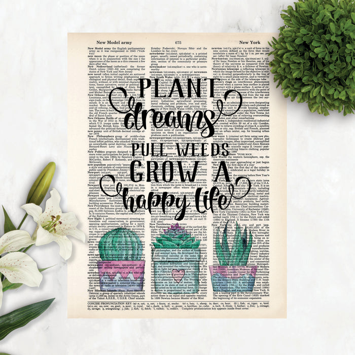 text plant dreams pull weeds grow a happy life with three potted cactus printed on a dictionary pagetext plant dreams pull weeds grow a happy life with three potted cactus printed on a dictionary page