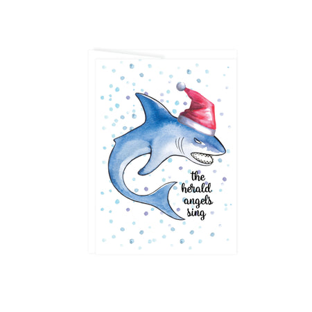 Holiday greeting card with a shark wearing a santa hat with blue bubbles in the background with the text the herald angels sing, this greeting card is blank inside
