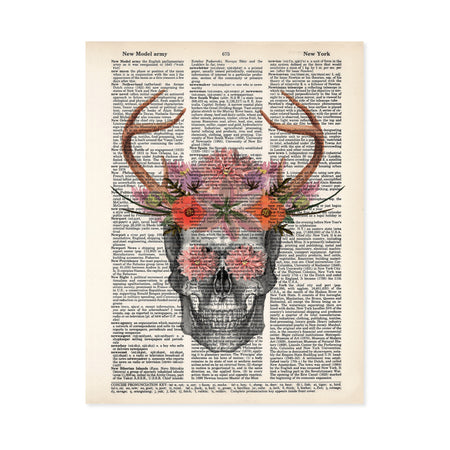 pencil sketch of a skull with watercolor antlers and flowers in pinks, purples, and salmon tones with flowers covering the eyes printed on a dictionary page