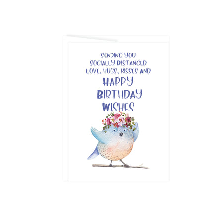 greeting card sending you socially distanced love, hugs, kisses, and happy birthday wishes with a cute arms open blue and tan bird standing on a twig wearing a floral crown in shades of pink with greenery, card is blank inside