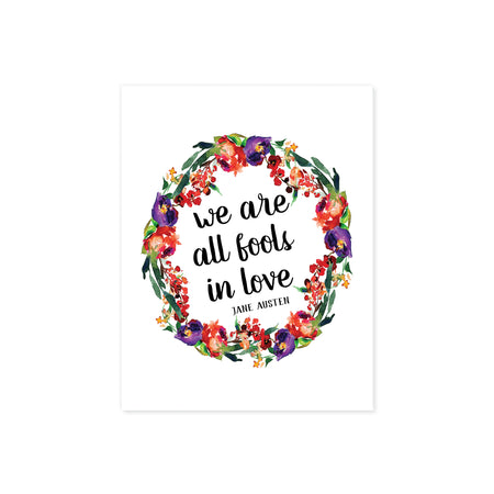 we are all fools in love Jane Austen quote surrounded by a watercolor wreath in purple, red, and green colors printed on matte white paper