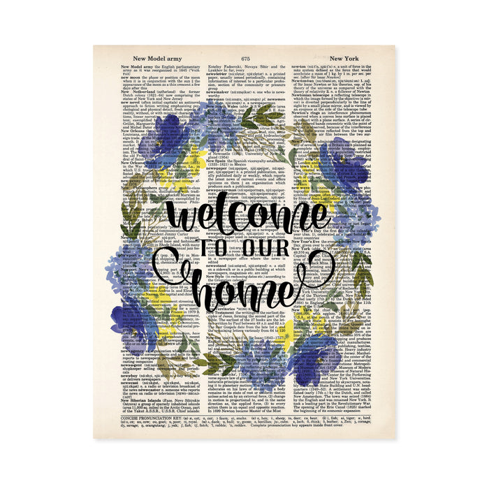 welcome to our home surrounded by a watercolor wreath in blue and yellow colors with greenery printed on a dictionary page