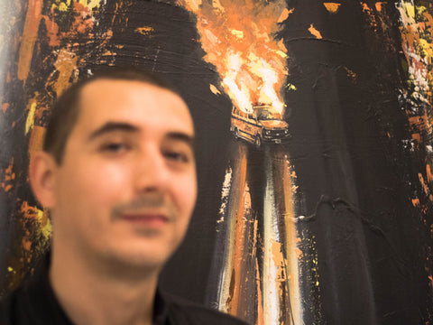 CIFUENTES standing in front of his artwork titled Tangles Burnt