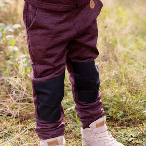 kid wearing Tufte wool fleece pants in burgundy outside