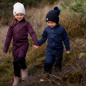 little boy and girl holding hands outside wearing tufte wool fleece set